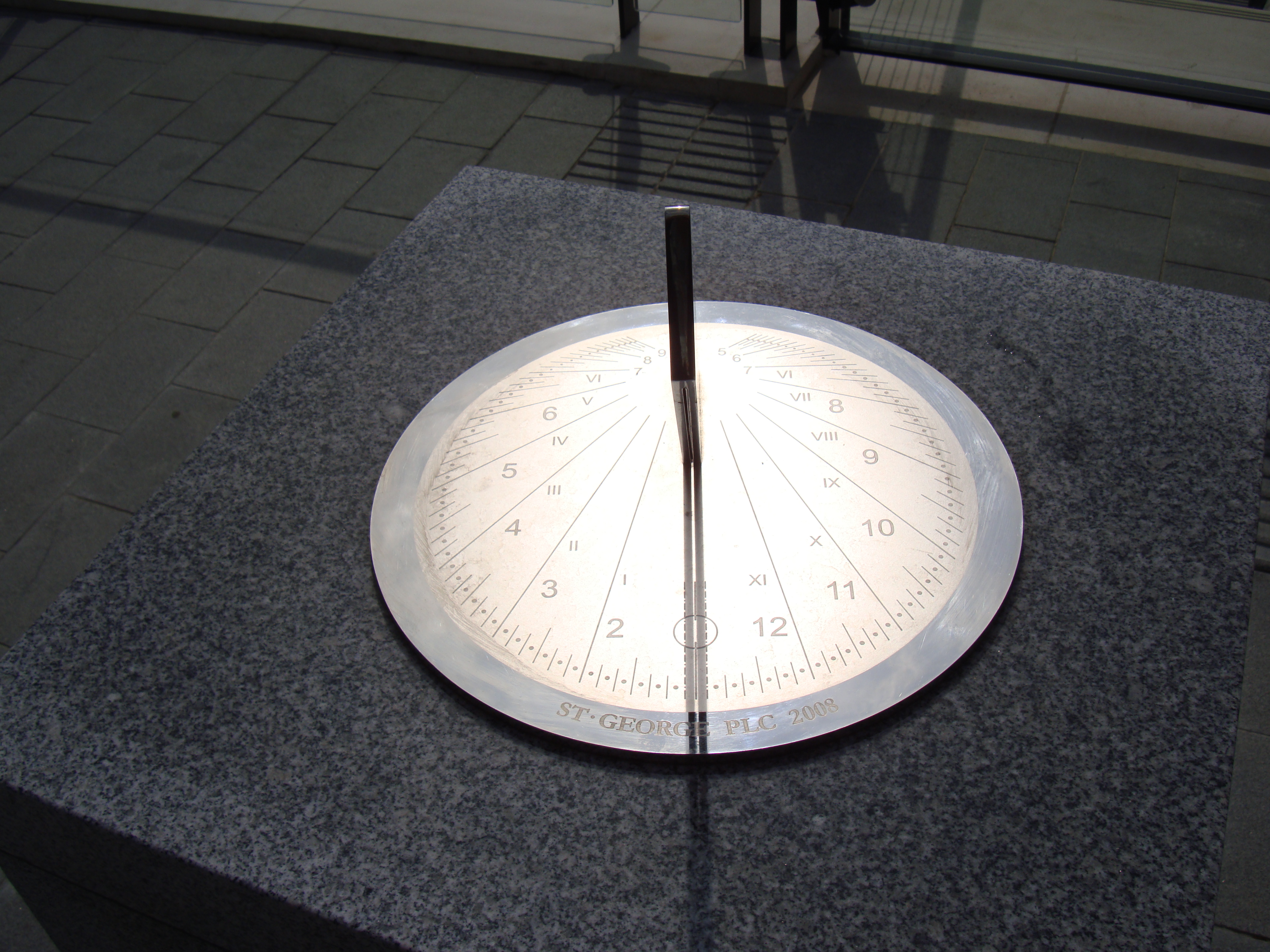 Stainless steel sundials in their settings